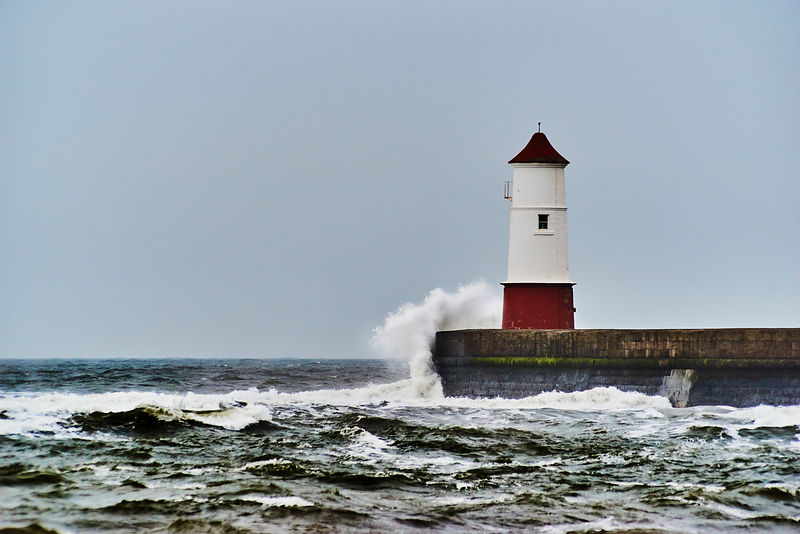 Waves breaking on a lighthouse