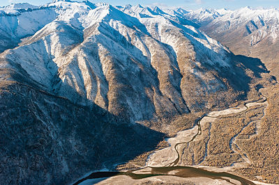Mountainous landscape with East Sayan and Shumak river, Siberia, Russia, October 2010.