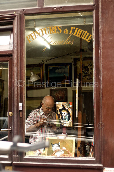 Artist at Work in the Window of his Shop