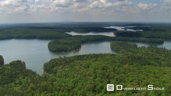 Flight over tree-covered islands of Lake Lanier, Georgia.