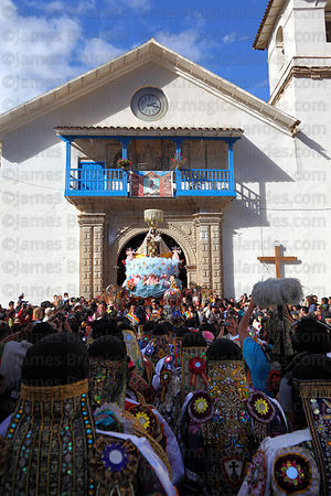 Figure of Virgen del Carmen leaves church for main procession around village , Paucartambo , Peru