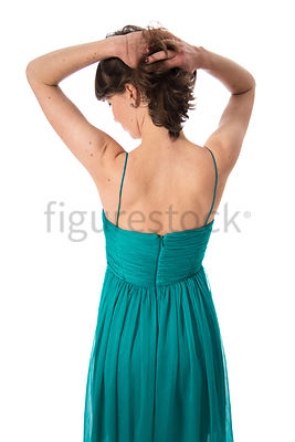 A woman in a dress from behind – shot from eye level.