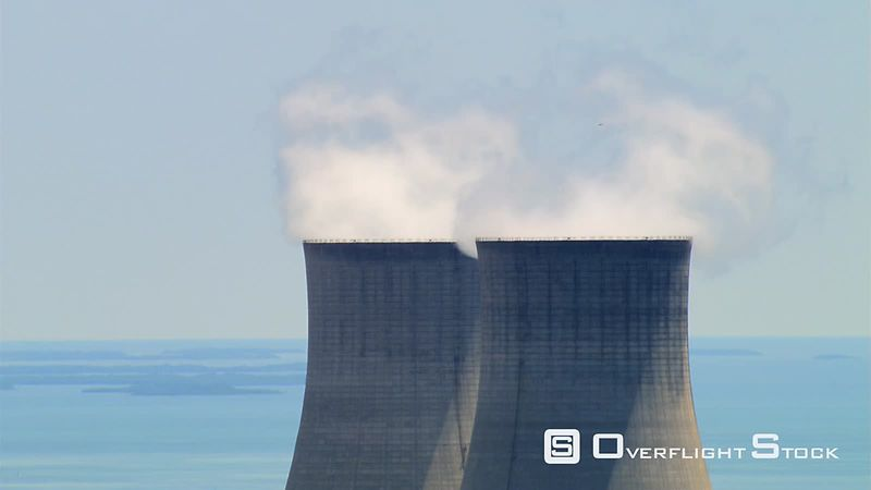 Close flight past nuclear cooling towers, with zoom-out