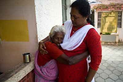 India - Cuddalore - Parvati an elderly resident cuddles the manager Amudha