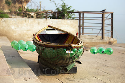 A small handmade boat using 2 liter plastic soda bottles for flotation, Varanasi, India