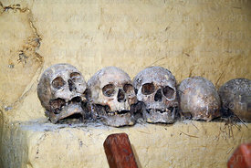 Human skulls on ledge in church at Markacocha, Patacancha Valley, Cusco Region, Peru