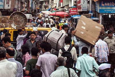 Just another typical day in the Crawford Market area of Mumbai, India, where people, goats, dogs, cats, cars, trucks, taxis, ...