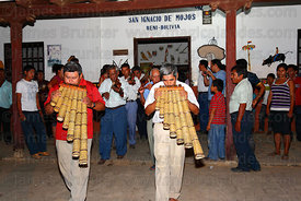 Musicians playing Yuruhys (Bajones Chicos) leaving the Mojeño Cabildo (parliament) building for a procession, San Ignacio de ...