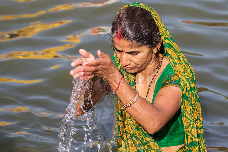 Woman Taking a Holy Dip in the Shipra River