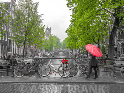 Woman with umbrella by the canal, Amsterdam