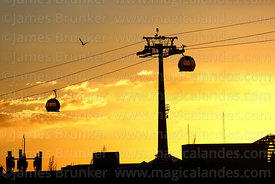 Blue Line cable cars and pylon silhouetted against sunset, Rio Seco, El Alto, Bolivia