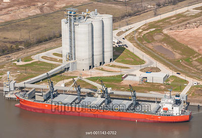 Cement is loaded on a dry bulk cargo ship