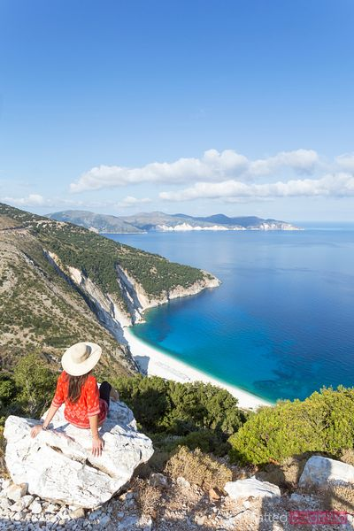 Woman looking down to Myrtos beach, Kefalonia, Greek Islands, Greece