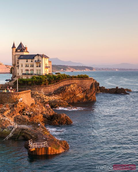 Old house on the cliffs at sunset, Biarritz, France