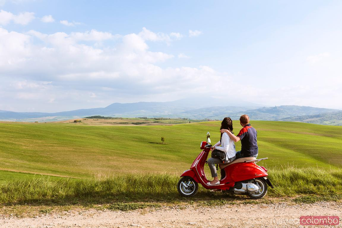 Tourists on a Vespa scooter in Tuscany, Italy