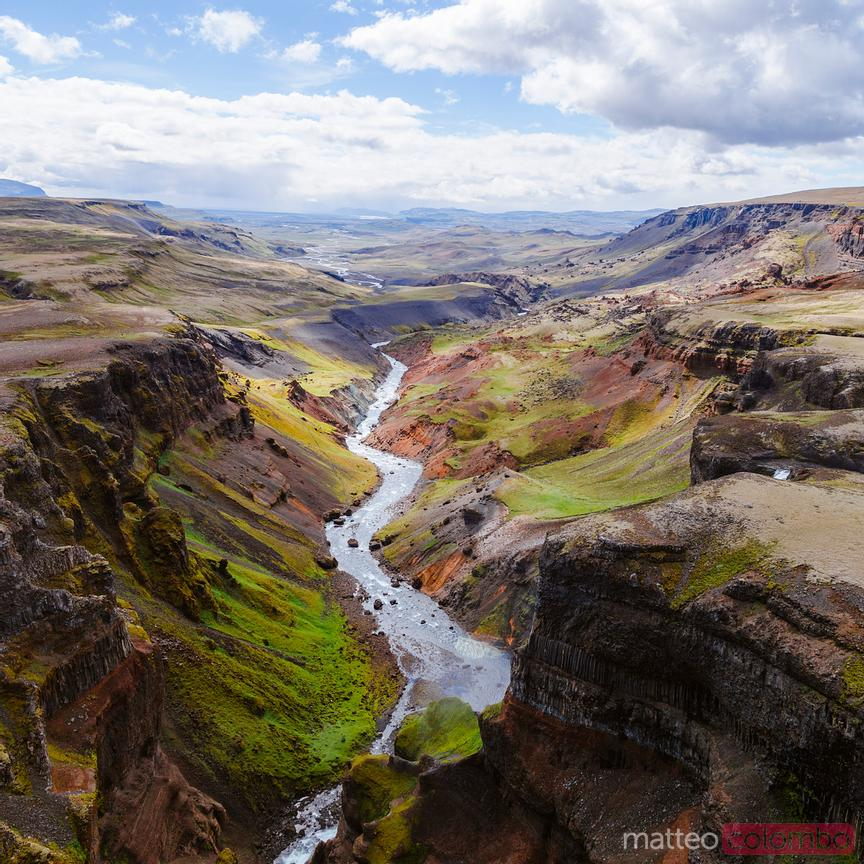 Aerial drone view of river and valley in summer, Iceland