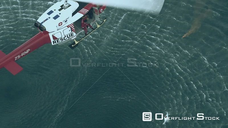 Aerial of a paramedic jumping into the sea from a rescue helicopter Cape Town Western Cape South Africa