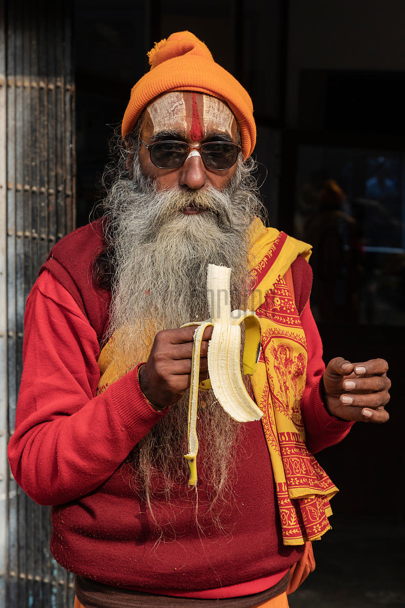 Portrait of a Sadhu Eating a Banana