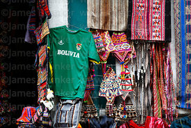 Bolivian national football team shirt and textiles hanging outside shop in Calle Linares, La Paz, Bolivia
