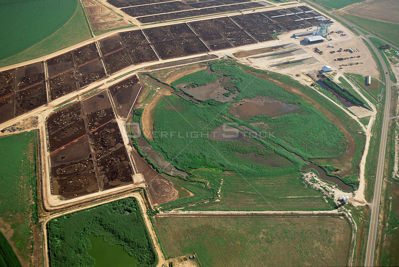 Aerial of intensive livestock rearing with dried out playa lake , Texas Panhandle, USA