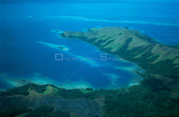 Aerial view of Coral Reefs and deforested hills along the coast of Fiji.