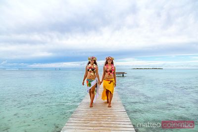 Local tahitian girls in traditional dress, Moorea, French Polynesia