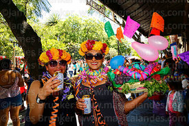 Friends / comadres holding cans of beer during the Comadres festival, Tarija, Bolivia