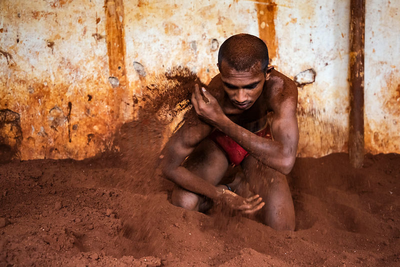 Kusti Wrestler Applies Sand to his Body During Practice