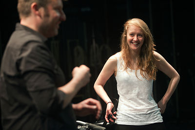 UK - Hull - Director Jamie Beale directs drama student Sarah Green from Hull University during a cycling sequence for an upco...