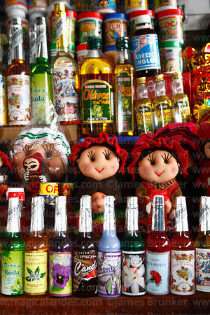 Stall selling textile dolls and natural perfumes made from flowers, San Pedro market, Cusco, Peru