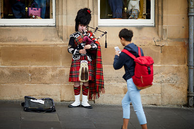 A man playing the bagpipes