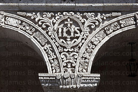 Christogram stone carving detail , La Compañia de Jesus church cloisters , Arequipa , Peru