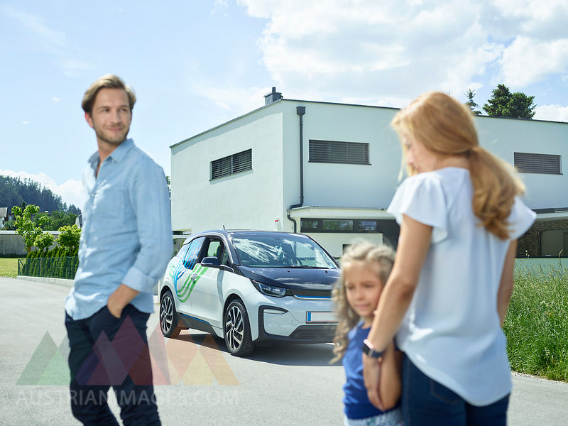 Austrianimages Com Family With Electric Car In Front Of House