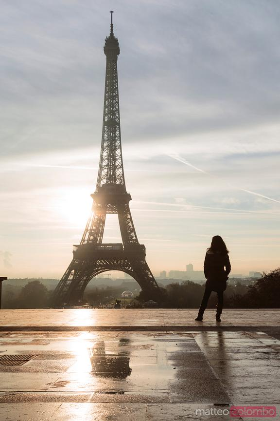 Lonely woman in front of the Eiffel tower, Paris