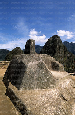 Intihuatana or Hitching Post of the Sun and Huayna Picchu mountain, Machu Picchu, Peru