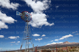 Small windmill for pumping water with Agua Sustentable / Sustainable Water written on vane , Lagunas, Sajama National Park, B...