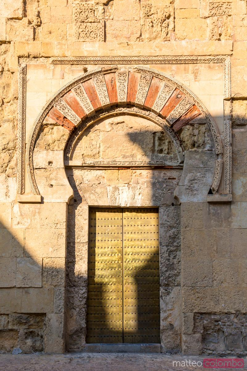 Ornate door on the outer walls of the Mezquita (Mosque) of Cordoba