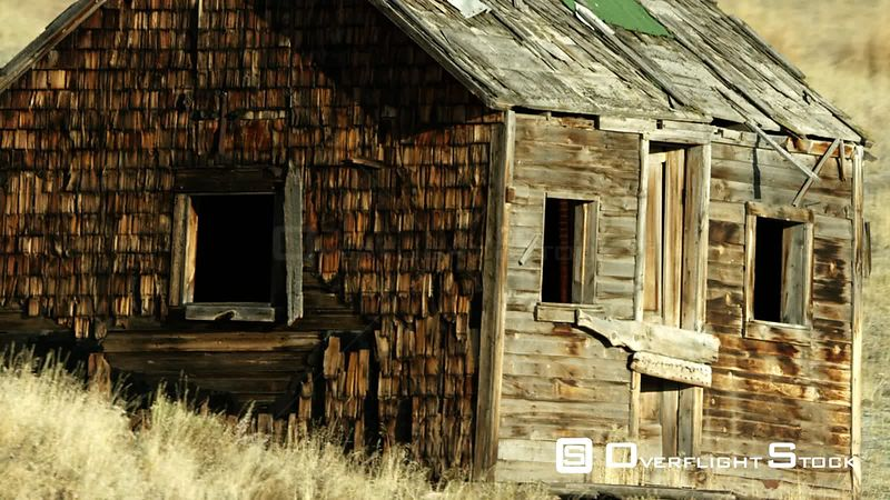 An abandoned mountain cabin sits in the foothills of the Gallatin mountain range in southwestern Montana