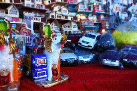 Miniature cars, houses and a white elephant in market for Alasitas festival, Puno, Peru
