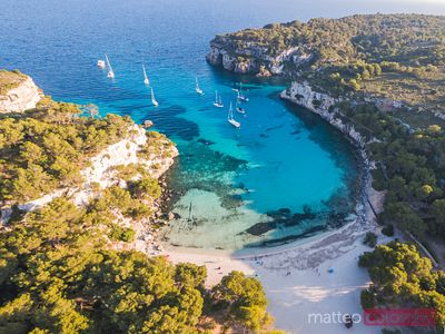 Aerial of Cala Macarella beach at sunset, Menorca
