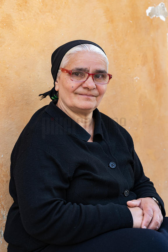 Portrait of a Sarda Woman Outside a Church