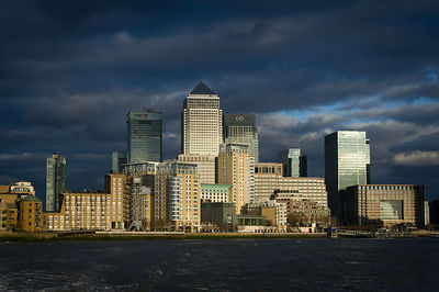 Canary Wharf sunlit from the Thames