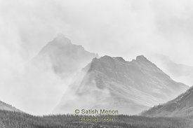 Hills engulfed in forest fire smoke, Glacier National Park, Montana, USA