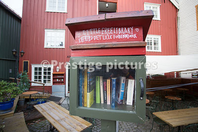 Very small book lending library in a case outside a local store in the Bakklandet area of Trondheim
