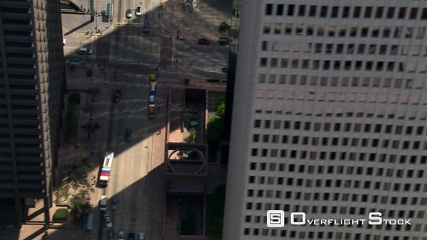 Flight through downtown Houston, with steep look down into streets.