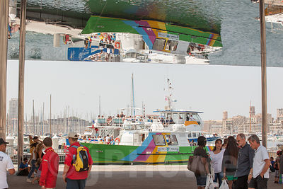Rainbow Coloured boat reflected in the Vieux Port pavilion