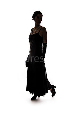 A silhouette of a vintage 1920s - 1930s woman in a black dress – shot from eye level.
