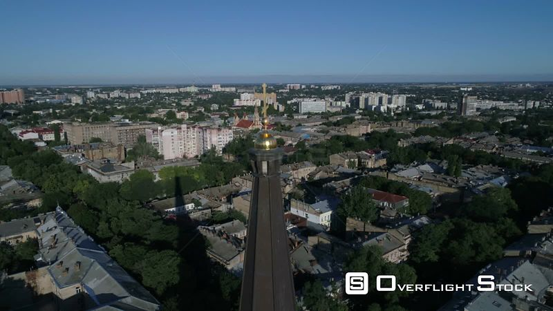 Drone camera flies slowly back from the cross on top of Preobrazhensky Cathedral on Saborna Square in Odessa Ukraine. Taken o...