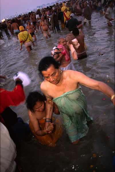 Two women who have just bathed in the Ganges