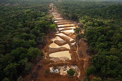 Aerial view of Alluvial Gold Mine in the rainforest, Guyana, December 2009